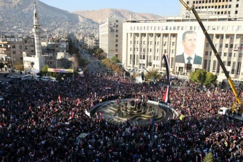 Supporters of Syrian President Bashar al-Assad rallying in Damascus